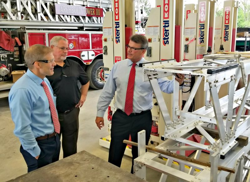 President Drew Sutphen and general manager Todd Winnenberg explain the strength of a Sutphen aerial ladder to Rep. Jordan.
